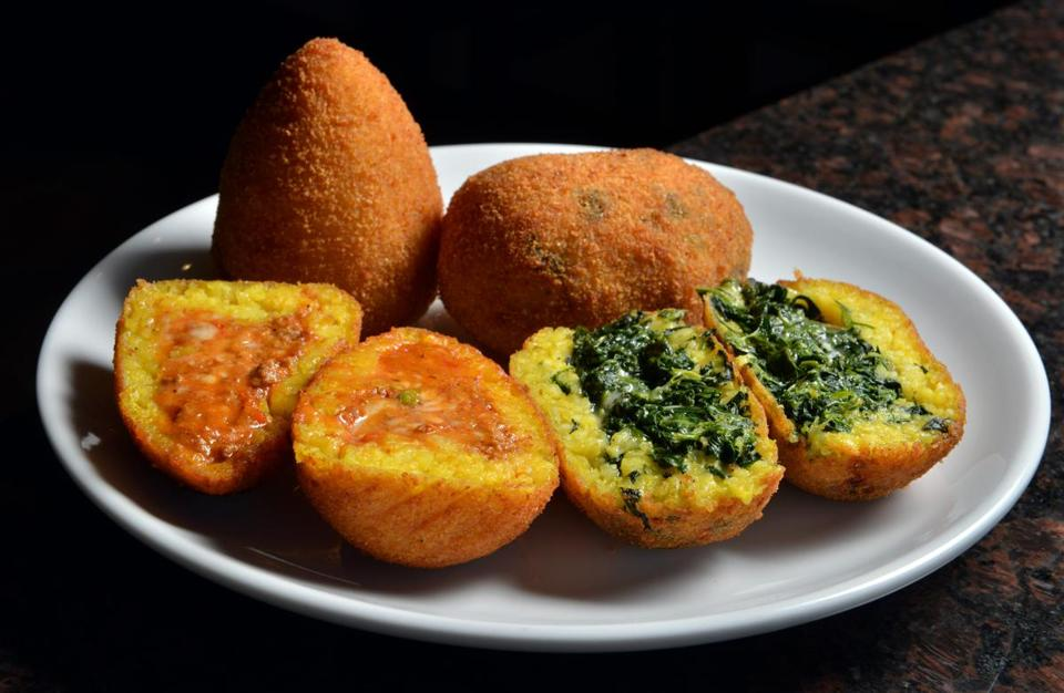 Arancini, fried rice balls stuffed with, from left, meat, cheese & peas, and spinach & cheese, at Brelundi Restaurant abutting the Waltham commuter rail station. Josh Reynolds for The Boston Globe (Lifestyle, bhange)